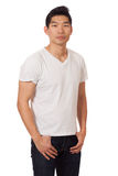 Casual Young Man. Young man in white t-shirt and jeans. Studio shot over white stock photo