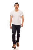 Casual Young Man. Young man in white t-shirt and jeans. Studio shot over white stock image