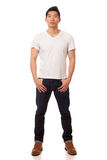 Casual Young Man. Young man in white t-shirt and jeans. Studio shot over white stock photography