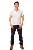 Casual Young Man. Young man in white t-shirt and jeans. Studio shot over white Stock Photos