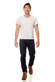 Casual Young Man. Young man in white t-shirt and jeans. Studio shot over white royalty free stock photo