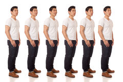 Casual Young Man. Young man in white t-shirt and jeans. Studio shot over white royalty free stock image