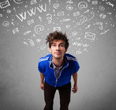 Casual young man with abstract white media icon doodles Stock Photo