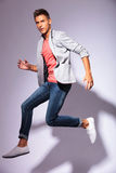 Casual young man in the air Stock Images