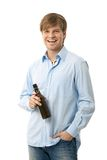 Casual young man with bottle of beer Royalty Free Stock Image
