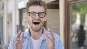 Casual Young Man Celebrating Success while Standing Outdoor stock video