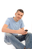 Casual young man with cell phone and headphones Stock Photos