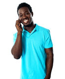 Casual young man communicating on phone Royalty Free Stock Photography