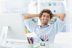 Casual young man with computer in a bright office Stock Images