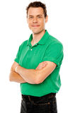 Casual young man with crossed arms Stock Image