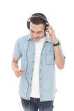 Casual young man enjoy music wearing headphones Royalty Free Stock Photos