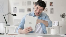 Casual Young Man Excited for Results on Tablet stock footage