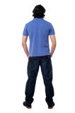 Casual young man facing the wall Royalty Free Stock Photography