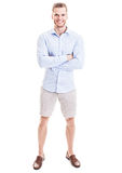 Casual Young Man with Folded Arms. Casual smiling young man with arms folded in button shirt, shorts and loafers Royalty Free Stock Image