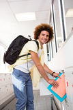 Casual young man with folders in office Royalty Free Stock Image