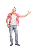 Casual young man gesturing with his hand Royalty Free Stock Photography