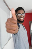 Casual young man gesturing thumbs up Stock Image