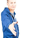 Casual young man giving a handshake Royalty Free Stock Photos