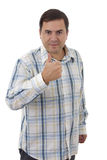 Casual young man going thumb up, isolated. On white Royalty Free Stock Images