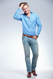 Casual young man with hand in pocket and in hair Royalty Free Stock Photo