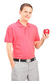 Casual young man holding an apple Stock Photo