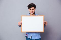 Casual young man holding blank board Stock Photo