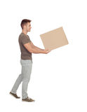 Casual young man holding a box. Isolated on a white background Royalty Free Stock Image