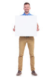 Casual young man holds blank board Royalty Free Stock Image