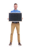 Casual young man holds a small blackboard Royalty Free Stock Photo