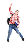 Casual young man jumping Stock Image