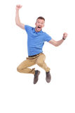 Casual young man jumps in the air. Casual young man cheering while jumping in the air. isolated on white Stock Photo