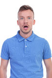 Casual young man left open mouthed. Portrait of a shocked young casual man looking into the camera. isolated on a white background Stock Images