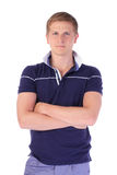 Casual young man looking at camera with arms crossed and satisfa Royalty Free Stock Image
