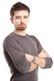 Casual young man looking at camera with arms crossed Royalty Free Stock Images