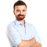 Casual young man looking at camera with arms crossed. And satisfaction Royalty Free Stock Photos