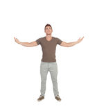 Casual young man looking up with arms extended Royalty Free Stock Image