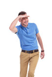 Casual young man looks away and smiles stock photo