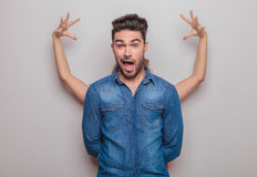 Casual young man making a funny face Royalty Free Stock Photo