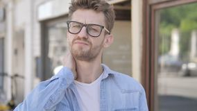 Casual Young Man with Neck Pain Standing Outdoor stock footage