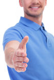 Casual young man offers handshake Stock Photos