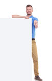 Casual young man with pannel shows thumb up Stock Photos