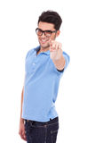 Casual young man pointing Royalty Free Stock Image