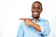 Casual young man pointing away Stock Photography