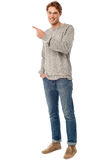 Casual young man pointing away Stock Images