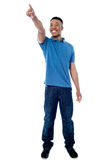 Casual young man pointing away Royalty Free Stock Photo