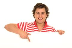 Casual young man pointing finger Stock Image