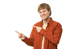 Casual young man pointing left Stock Images