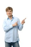 Casual young man pointing to blank space Royalty Free Stock Images
