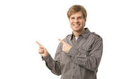 Casual young man pointing to blank space Stock Photography