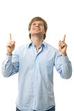 Casual young man pointing up Royalty Free Stock Photography